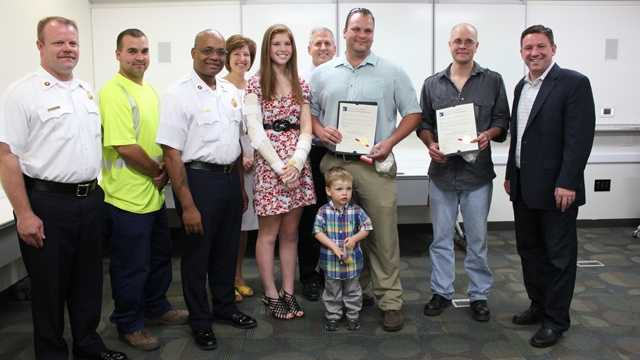 From left: Lisbon Volunteer Chief Casey McIntosh; Lisbon Volunteer Firefighter Darren Sirk; Assistant Chief John Butler of the Howard County Department of Fire and Rescue Services; Caroline Butler with her parents standing behind her; Justin Rix with his son standing in front of him; Doug Scheuch; Howard County Executive Ken Ulman.