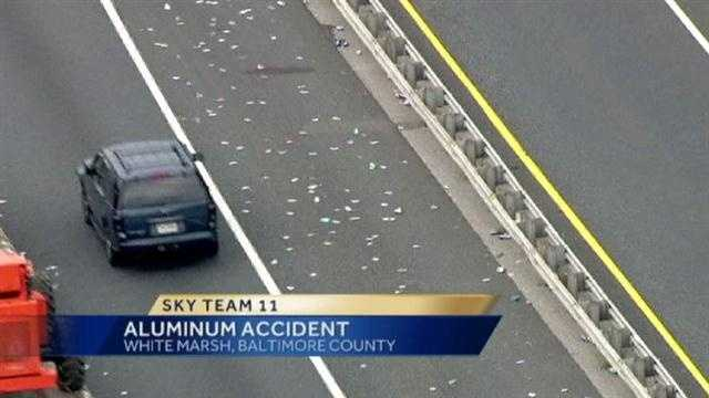 Hundreds of aluminum cans spilled out onto the inner look of the Interstate 695 beltway.