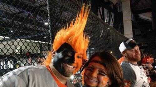 Ashley Lodz and her boyfriend, Derrick Hammel, spend a good bit of Thursday applying a heavy coating of face paint. Hammel's outfit also included a bright orange mohawk wig.