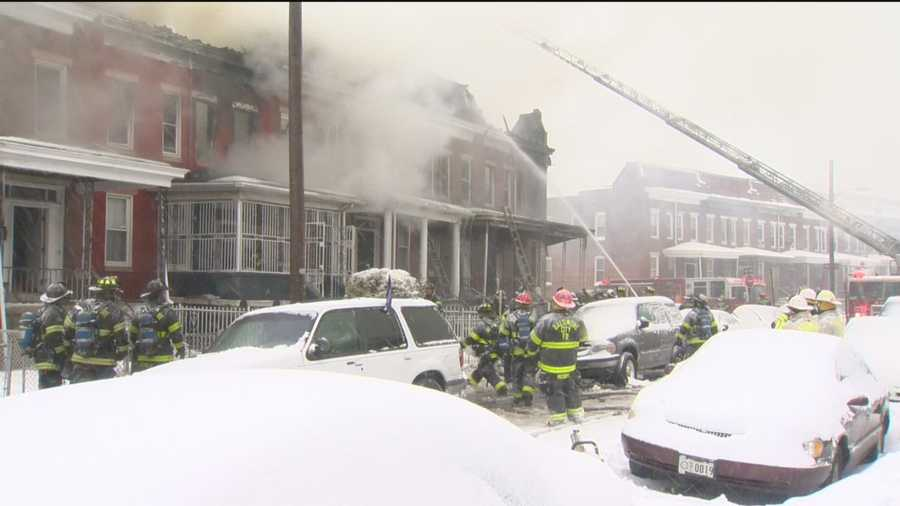 Dozens of people were displaced as Baltimore City fire crews struggled to put out a quickly moving fire that damaged nine homes during a snowstorm Thursday.