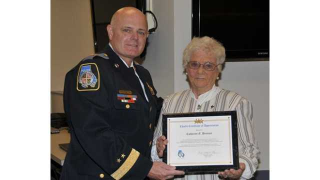 Catherine Drenner stands with Baltimore County police Chief Jim Johnson as he honored her on her retirement after 54 years of working as a crossing guard.