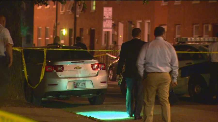 Three people are dead in a quadruple shooting in west Baltimore after two people emerged from vans and fired upon a crowd.