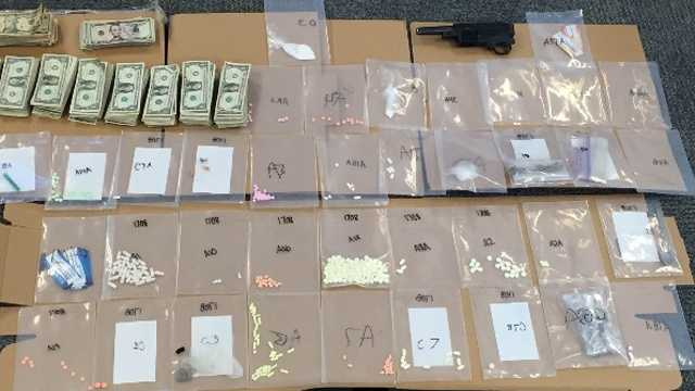 Anne Arundel County police confiscate drugs, guns, cash and drug paraphernalia from a house in Pasadena.