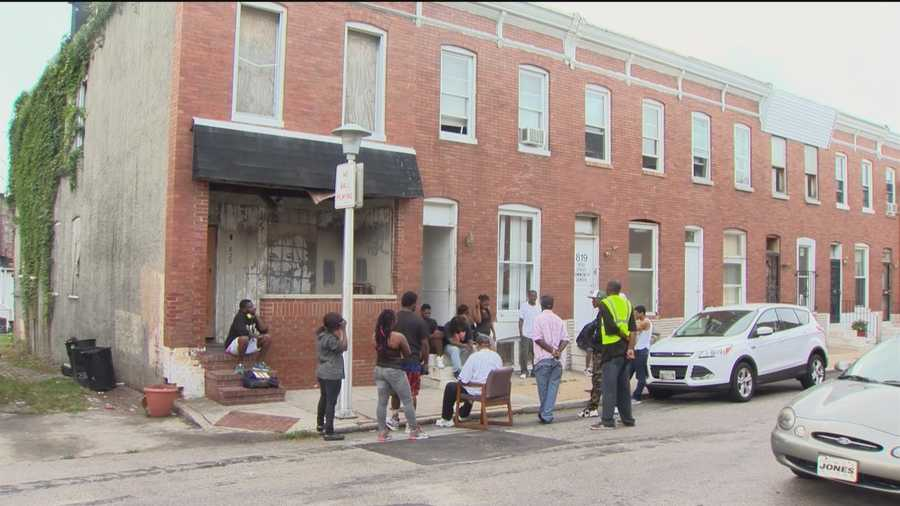 Residents of the east Baltimore neighborhood of Rose Street gather bright and early every morning outside the Rose Street Community Center to share information, express frustration, mediate disputes that could erupt into violence and clean their streets and discuss ways to combat crime.