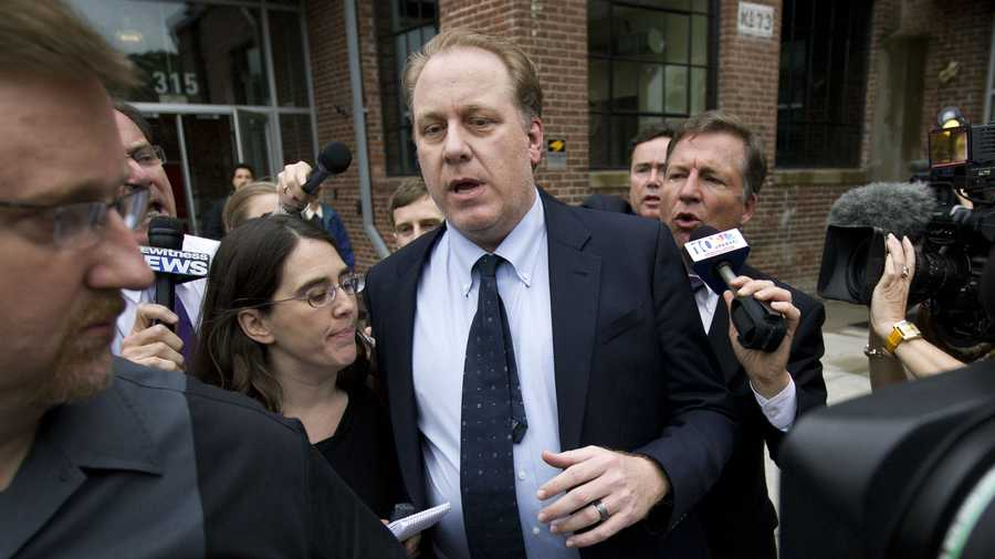 Curt Schilling, center, is followed by members of the media as he departs the Rhode Island Economic Development Corporation headquarters, in Providence, R.I., Wednesday, May 16, 2012. Schilling briefed Rhode Island Gov. Lincoln Chafee and economic development officials Wednesday during a closed-door meeting that could determine the fate of his video game company.