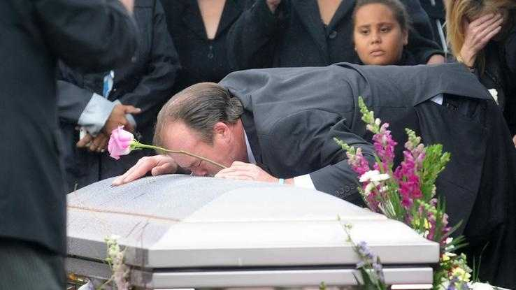 Bill Burnham leans over the casket of his wife, Mary Anne Kotsiopoulos, at Melrose Cemetery in Brockton on Saturday.