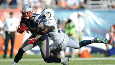 Miami Dolphins linebacker Karlos Dansby (58) grabs New England Patriots tight end Aaron Hernandez (81) during the second half of an NFL football game, Sunday, Dec. 2, 2012, in Miami.