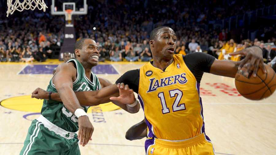 Los Angeles Lakers center Dwight Howard (12) battles Boston Celtics center Jason Collins for a rebound during the first half of their NBA basketball game, Wednesday, Feb. 20, 2013, in Los Angeles.