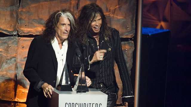 Inductees Joe Perry, left, and Steven Tyler from Aerosmith accept their award at the Songwriters Hall of Fame 44th annual induction and awards gala on Thursday, June 13, 2013 in New York.