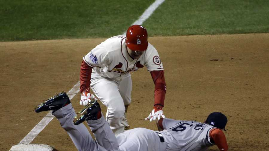 St. Louis Cardinals' Allen Craig gets tangled with Boston Red Sox's Will Middlebrooks during the ninth inning of Game 3 of baseball's World Series, Oct. 26, 2013, in St. Louis.
