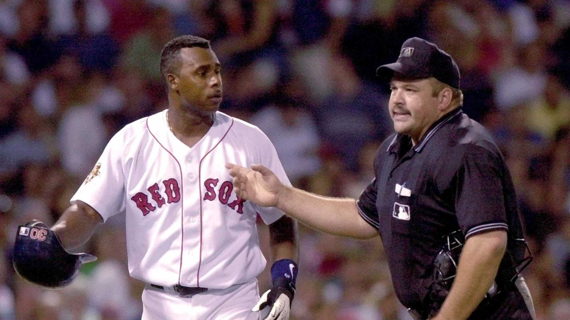 Boston Red Sox batter Jose Offerman is ejected by home plate umpire Wally Bell after arguing a strikeout in the sixth inning against the Seattle Mariners at Fenway Park in Boston, Thursday Aug. 16, 2001.