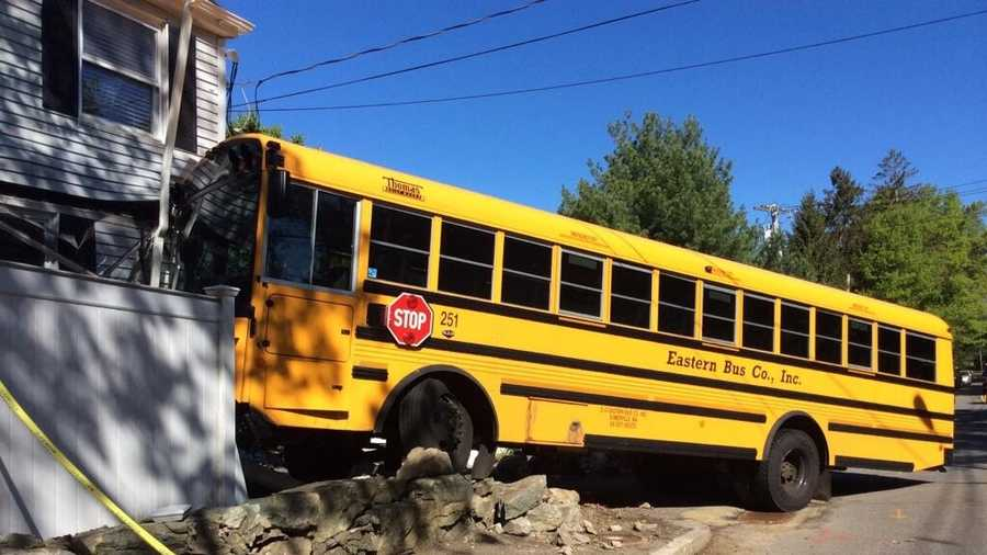 A private school bus crashed into a home in Newton.