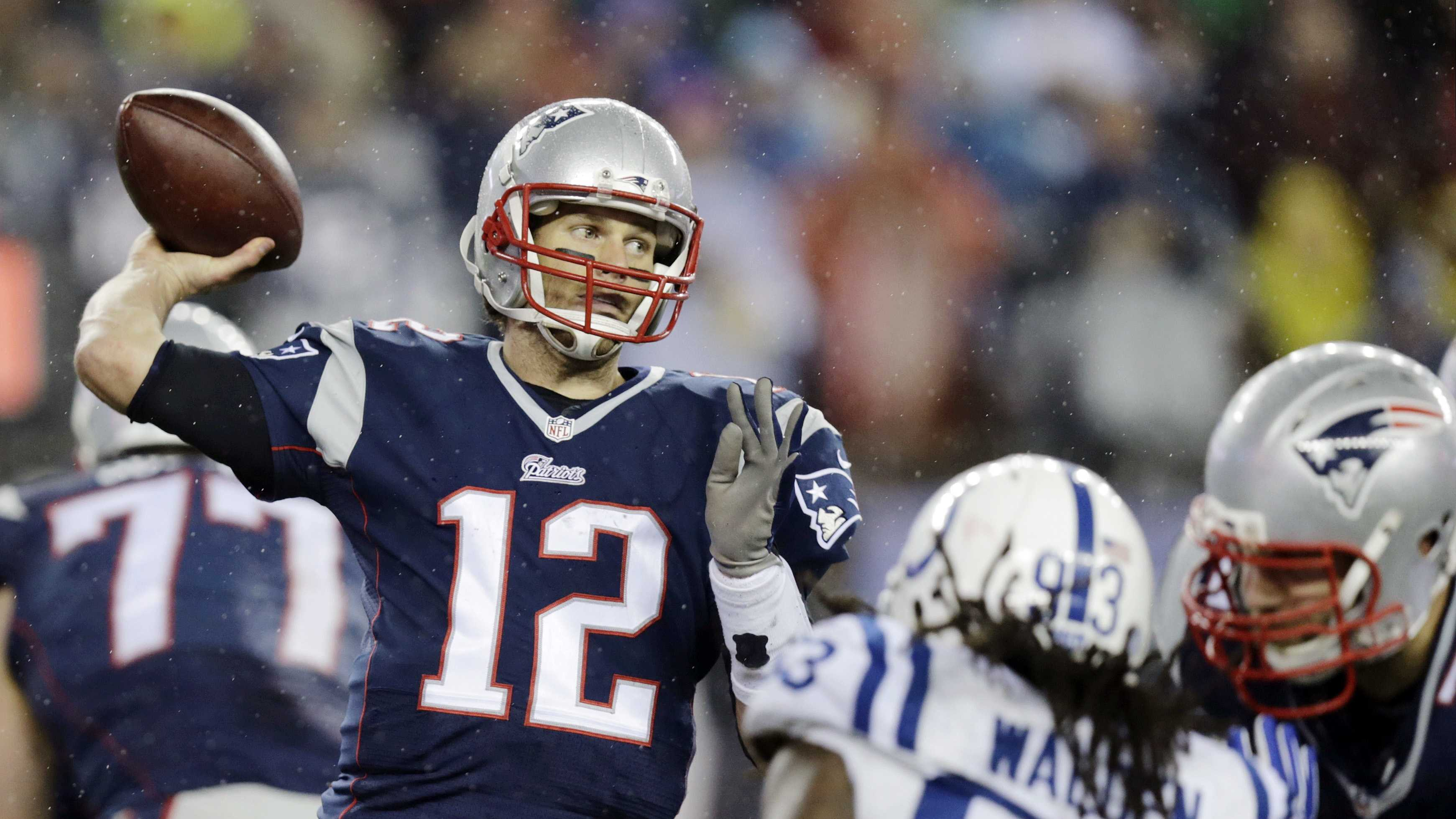 New England Patriots quarterback Tom Brady (12) passes against the Indianapolis Colts during the second half of the NFL football AFC Championship game Sunday, Jan. 18, 2015, in Foxborough, Mass.