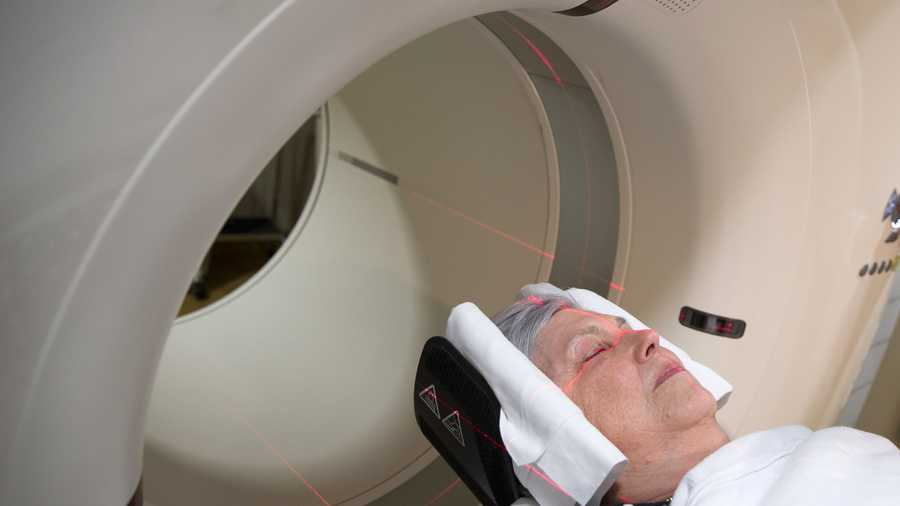 In this photo taken May 19, 2015, Judith Chase Gilbert, of Arlington, Va., is loaded into a PET scanner at Georgetown University Hospital in Washington. Gilbert shows no signs of memory problems but volunteered for a new kind of scan as part of a study peeking into healthy brains to check for clues about Alzheimer's disease.