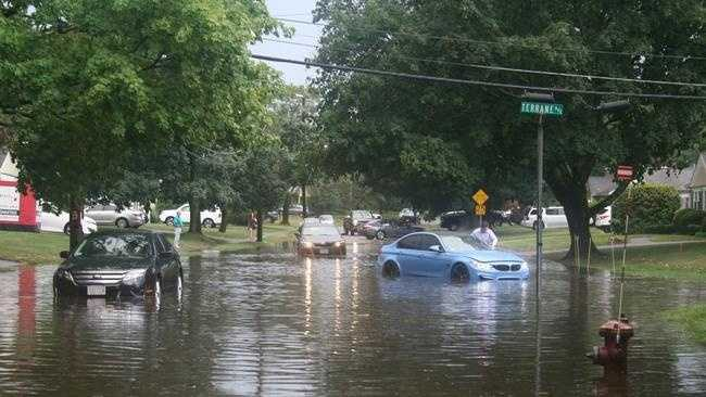 Cars on the flooded Wethersfield Road.