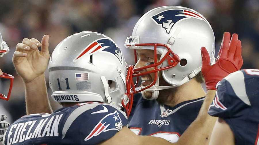 New England Patriots quarterback Tom Brady, right, celebrates a touchdown pass to Julian Edelman (11) in the second half of an NFL football game, Thursday, Oct. 29, 2015, in Foxborough, Mass. (AP Photo/Michael Dwyer)