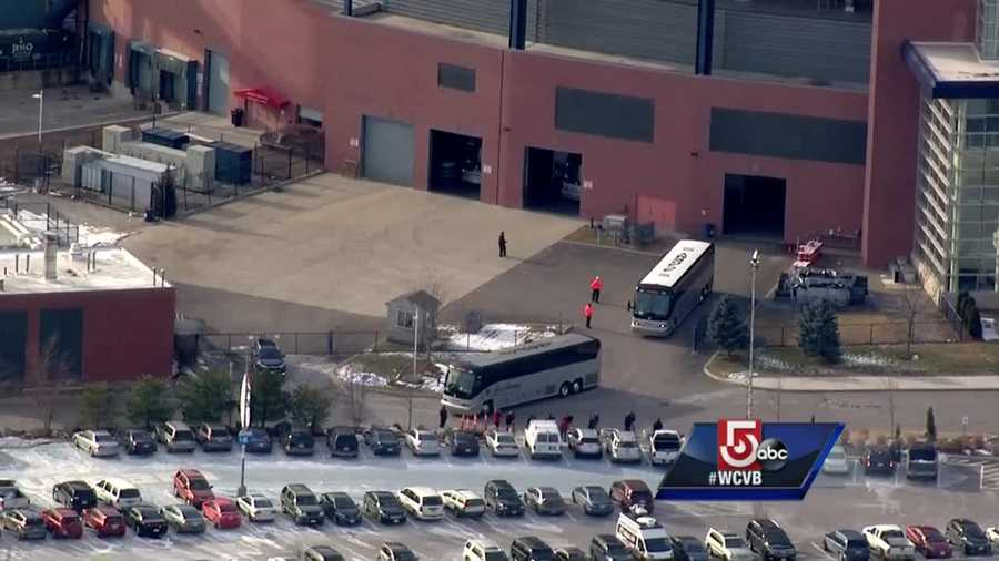 New England Patriots players leave Gillette Stadium for Denver.