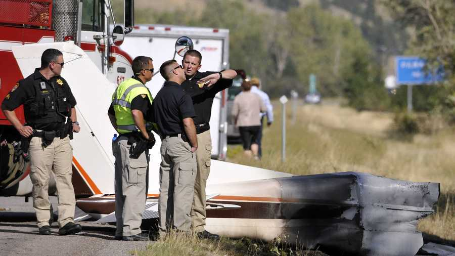 "Missoula County sheriff's deputies look at the wreckage of a Cessna 182 that crashed on the shoulder of Interstate 90 near Rock Creekont., on Sunday, Aug. 28, 2016. The crash killed 52-year-old Darrell Ward of Deer Lodge, a star of the History channel series ""Ice Road Truckers"" and pilot Mark Melotz, 56, of Arlee. Ward was returning to Montana to film a pilot episode of a documentary-type series about the recovery of plane wrecks."