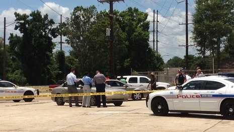 Baton Rouge police investigate the scene of a shooting involving a pregnant woman.