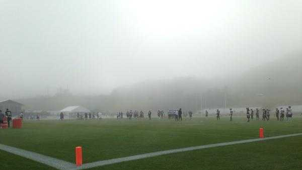Saints on the field during a foggy training camp.