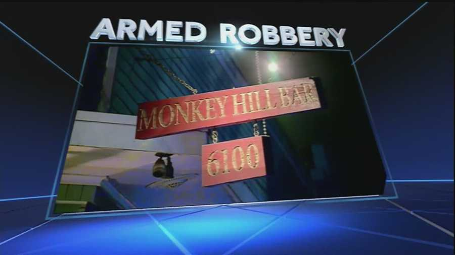 Police say they are looking for three suspects who robbed the bar with a gun.