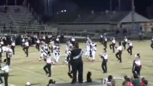 Parents of Spruce Creek band members are outraged after football players from the opposing team wouldn't leave the field for the band's pregame performance.