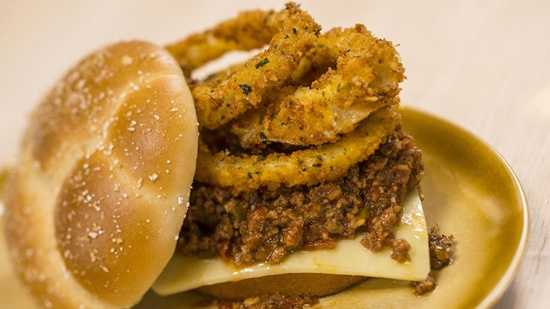 "House-made ""sloppy joe"" topped with onion rings"