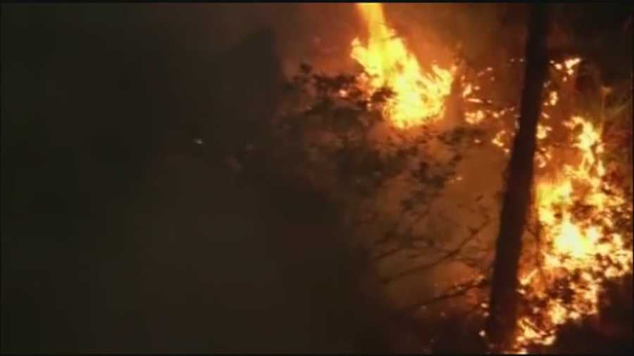 Officials are investigating an Orange County brush fire after the same spot went up in flames in less than two weeks.