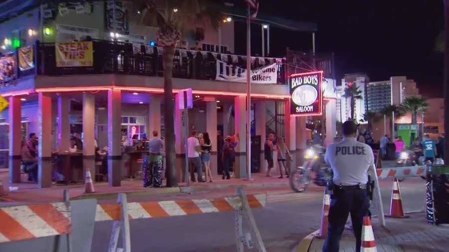 Police arrest two members of the Outlaws motorcycle gang after a disturbance at a bar.