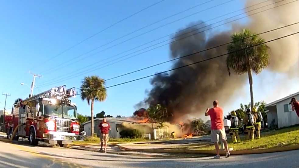 Firefighters from Brevard County, Indialantic, Melbourne and Indian Harbour Beach attack the fire.