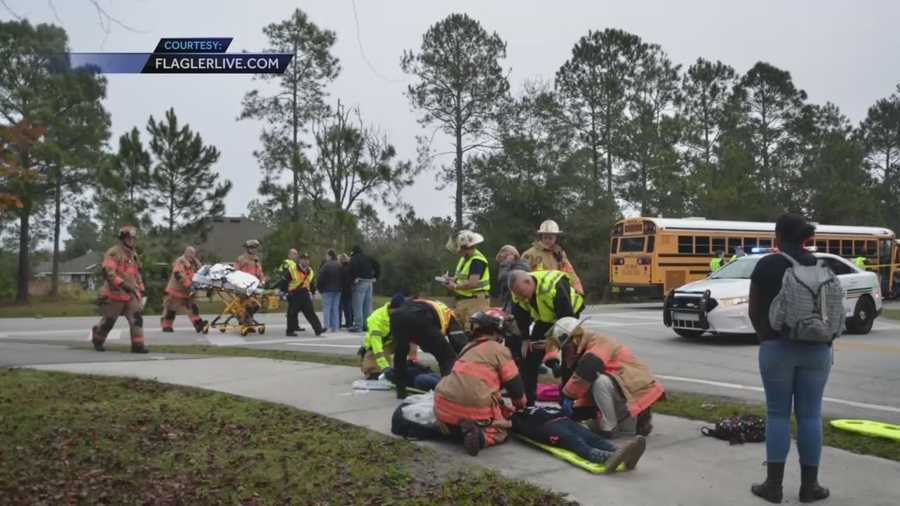 At least 13 Buddy Taylor Middle School students and three adults were injured in a crash between a school bus and a sedan in Palm Coast, according to officials.