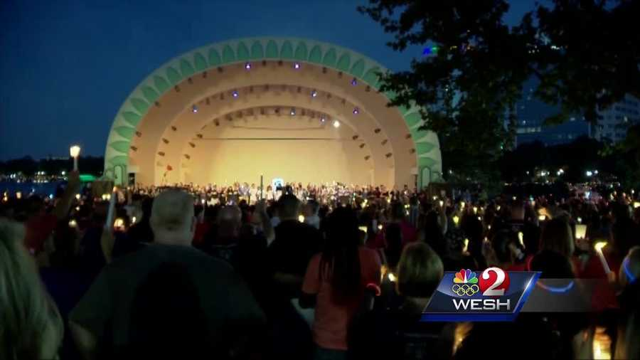 Tens of thousands who wanted to honor the victims of the Pulse nightclub shooting crowded the shores of Lake Eola Sunday night for a vigil.