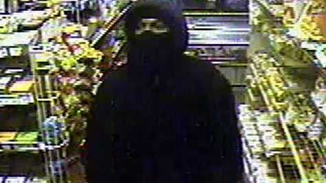 Police released this surveillance camera image of the robbery suspect.