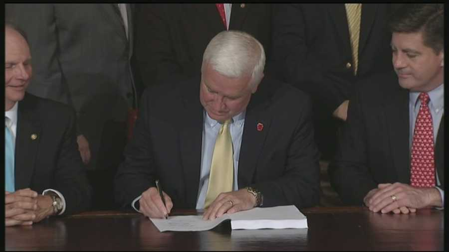Gov. Tom Corbett signed a new budget into law hours before the deadline.