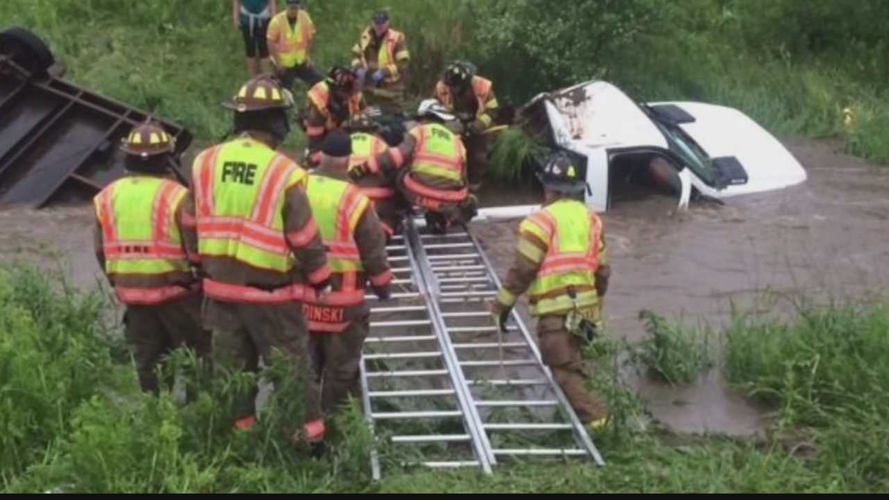 Officials say a truck crashed into the ditch during Wednesday's heavy rain.