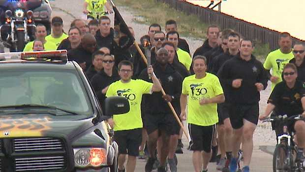 The Milwaukee leg of the Torch Run passed the Milwaukee Art Museum.