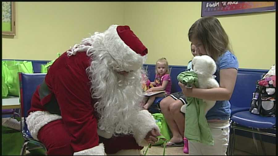 Christmas came early Monday for some children fighting blood disorders and cancer at the University of Louisville department of pediatrics and Kosair Children's Hospital.