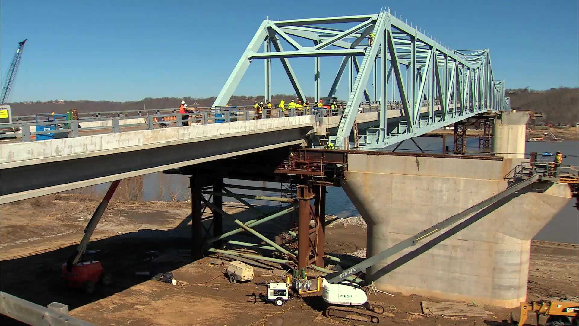 A 100-foot concrete section of the Kentucky side of the Milton-Madison Bridge slid into place Thursday morning. This timelapse video shows the less than 2-hour process from two angles.