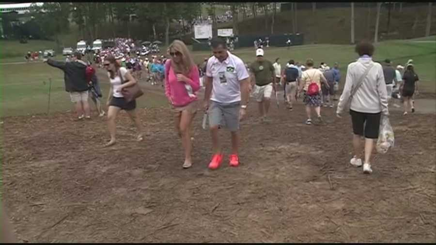 Muddy conditions at Valhalla Golf Club kept first aid workers busy treating golf fans for slips and falls.