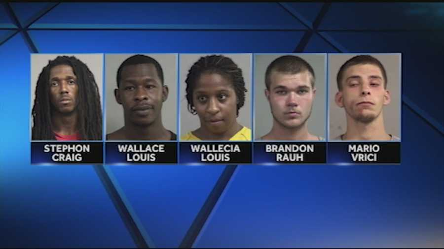 Five people were arrested and charged in connection with a string of robberies.