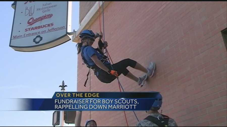 WLKY's Marissa Alter rappelled down the side of the Marriott downtown to benefit the Boy Scouts.