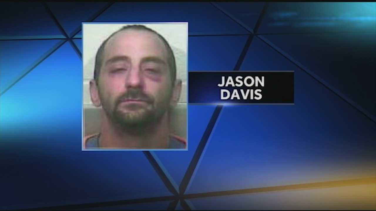 Jason Davis is charged with manslaughter after police discovered him driving on Highway 434 in Lebanon Junction with a dead woman in the car.