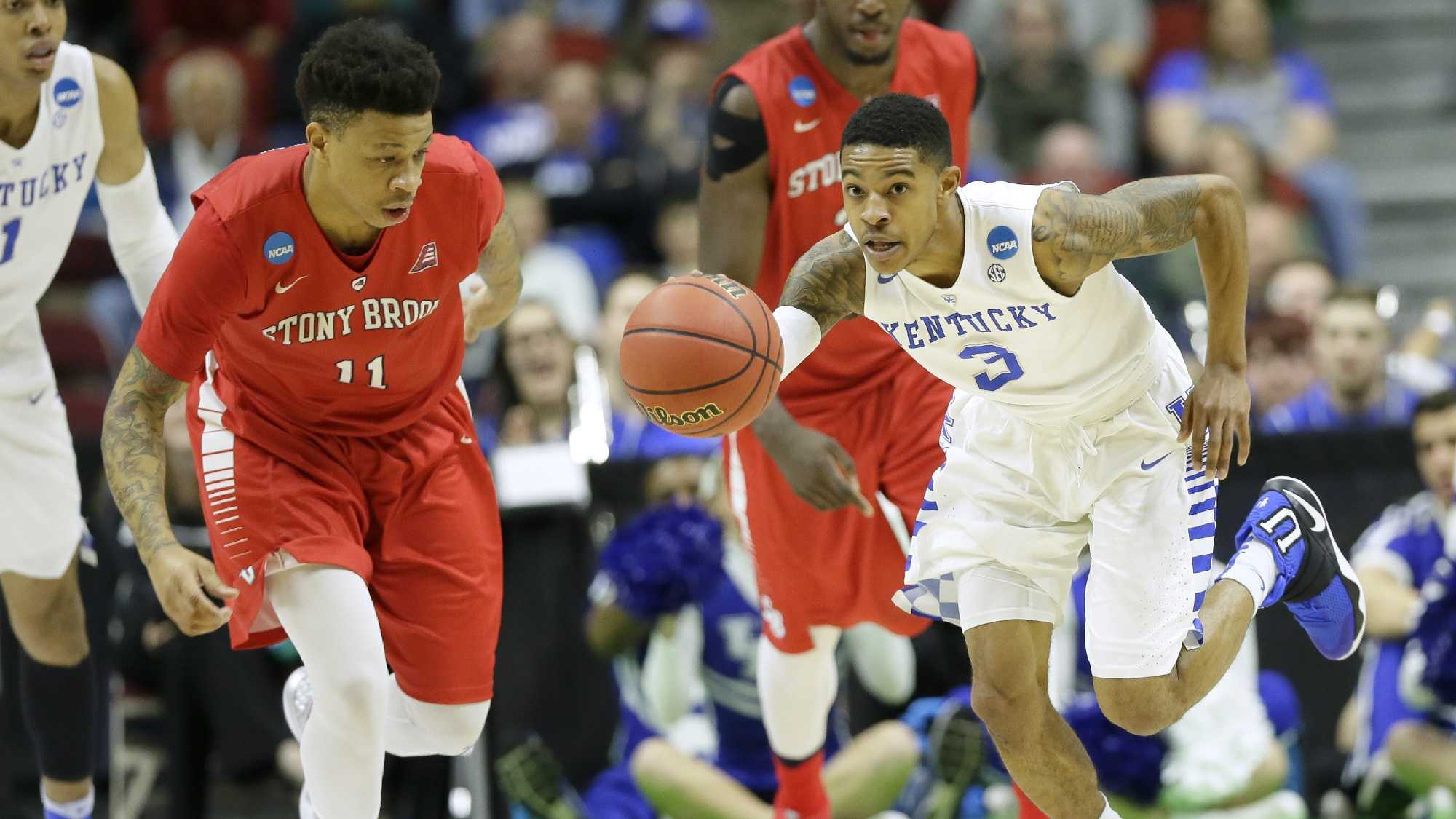 Kentucky guard Tyler Ulis drives upcourt past Stony Brook forward Rayshaun McGrew, left, during the first half of a first-round men's college basketball game in the NCAA Tournament, Thursday, March 17, 2016, in Des Moines, Iowa.