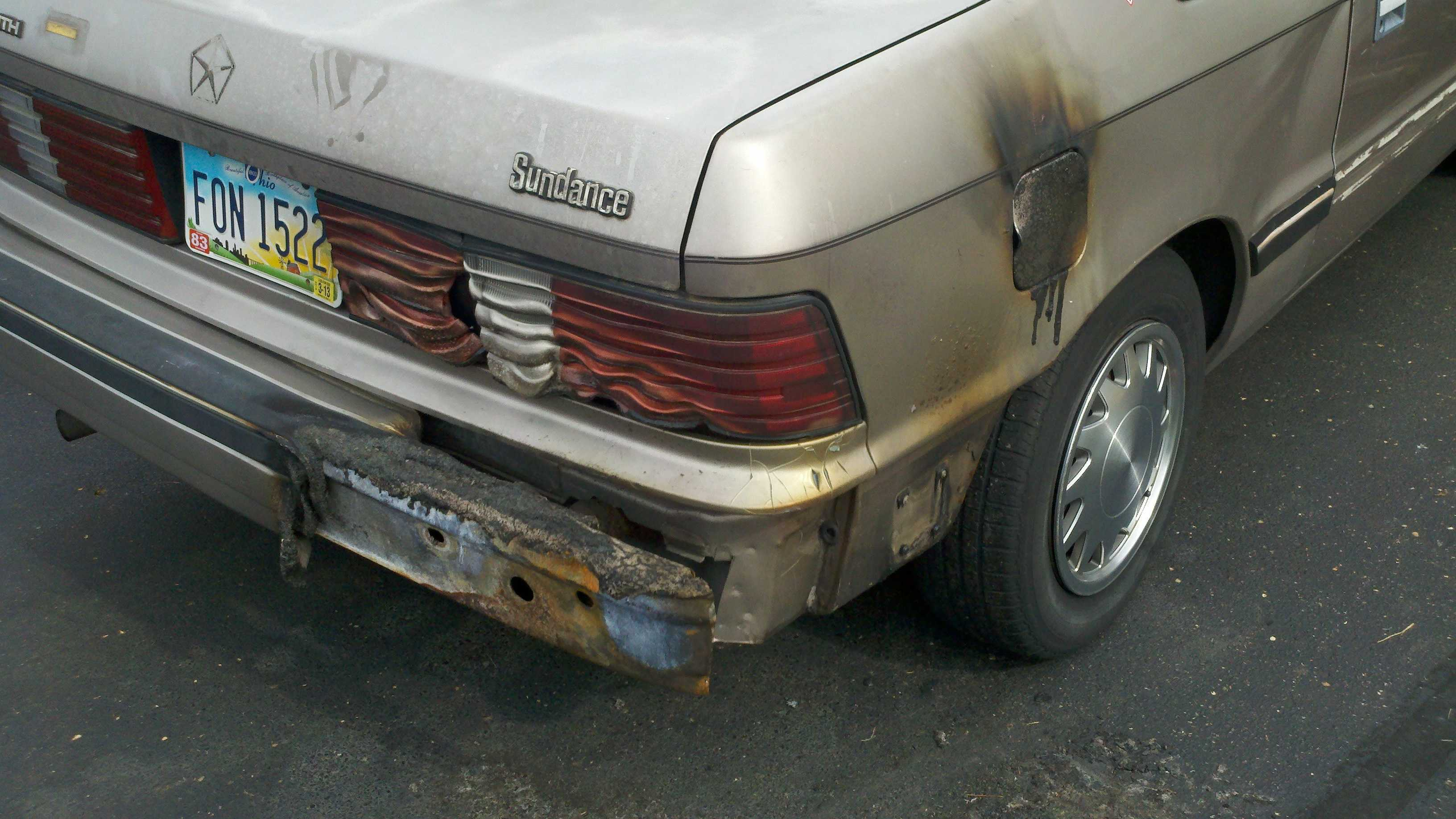 Vandals set fire to cars, slashed tires and broke windows in Landen