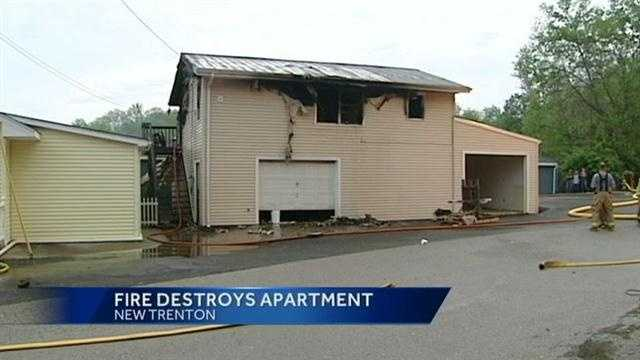 An apartment fire in New Trenton almost spread to a nearby business.