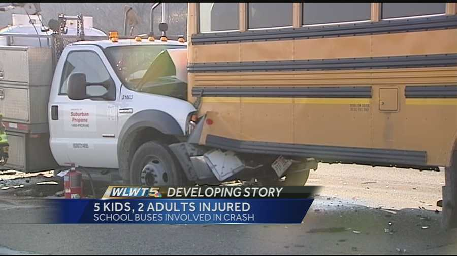 Five children on a school bus and two adults in a propane truck were injured after a chain-reaction crash involving two school buses and a tanker on Interstate 75.
