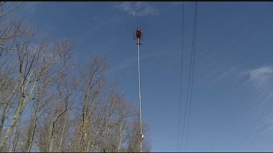 A 900-pound chainsaw hung 75 feet below a helicopter as a pilot's steady hand and watchful eye guided all 10 blades along a tree line, just 25 feet from 69 kV transmission lines.