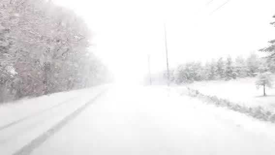 Snow fall comes down on roads in Aroostok County on Saturday morning.