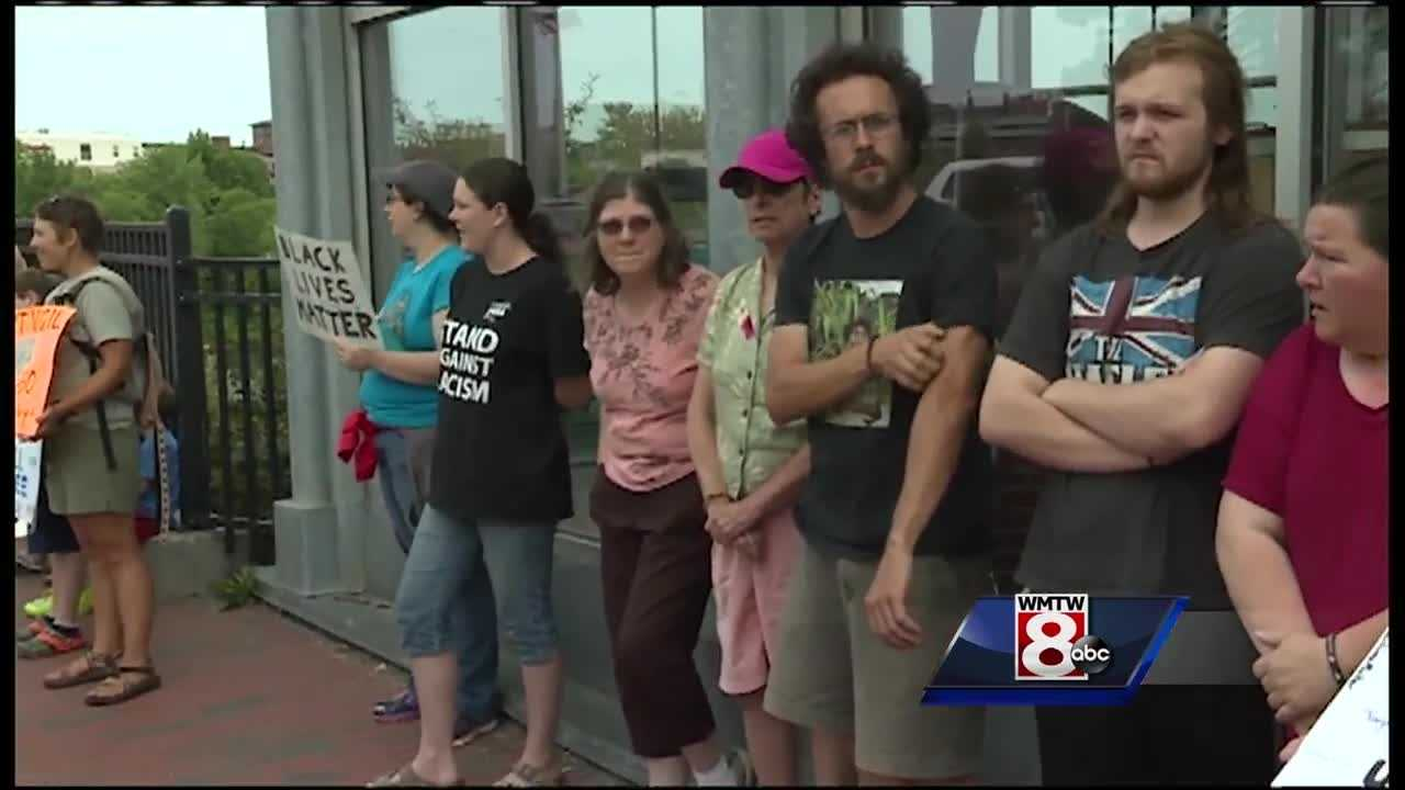 Protesters came together Monday for a monthly Black Lives Matter vigil along the Longley Bridge.