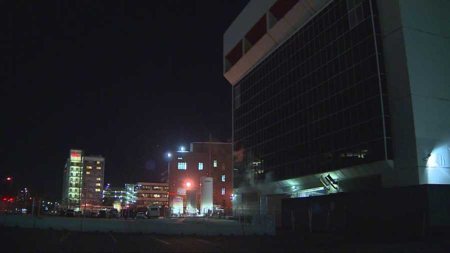 Police arrested a man after he was found with a gun and wearing body armor on the helipad at Boston Medical Center on Saturday.